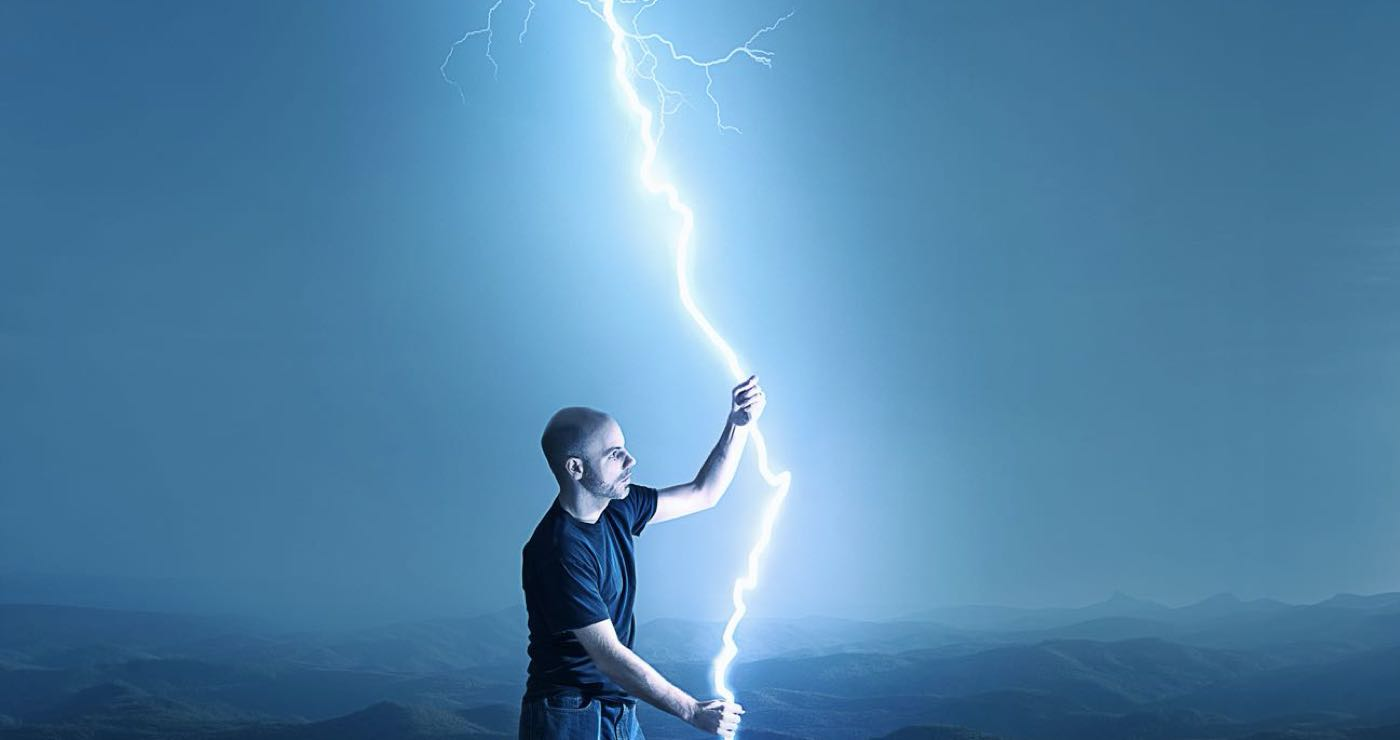 man holding a streak of lightning with two hands