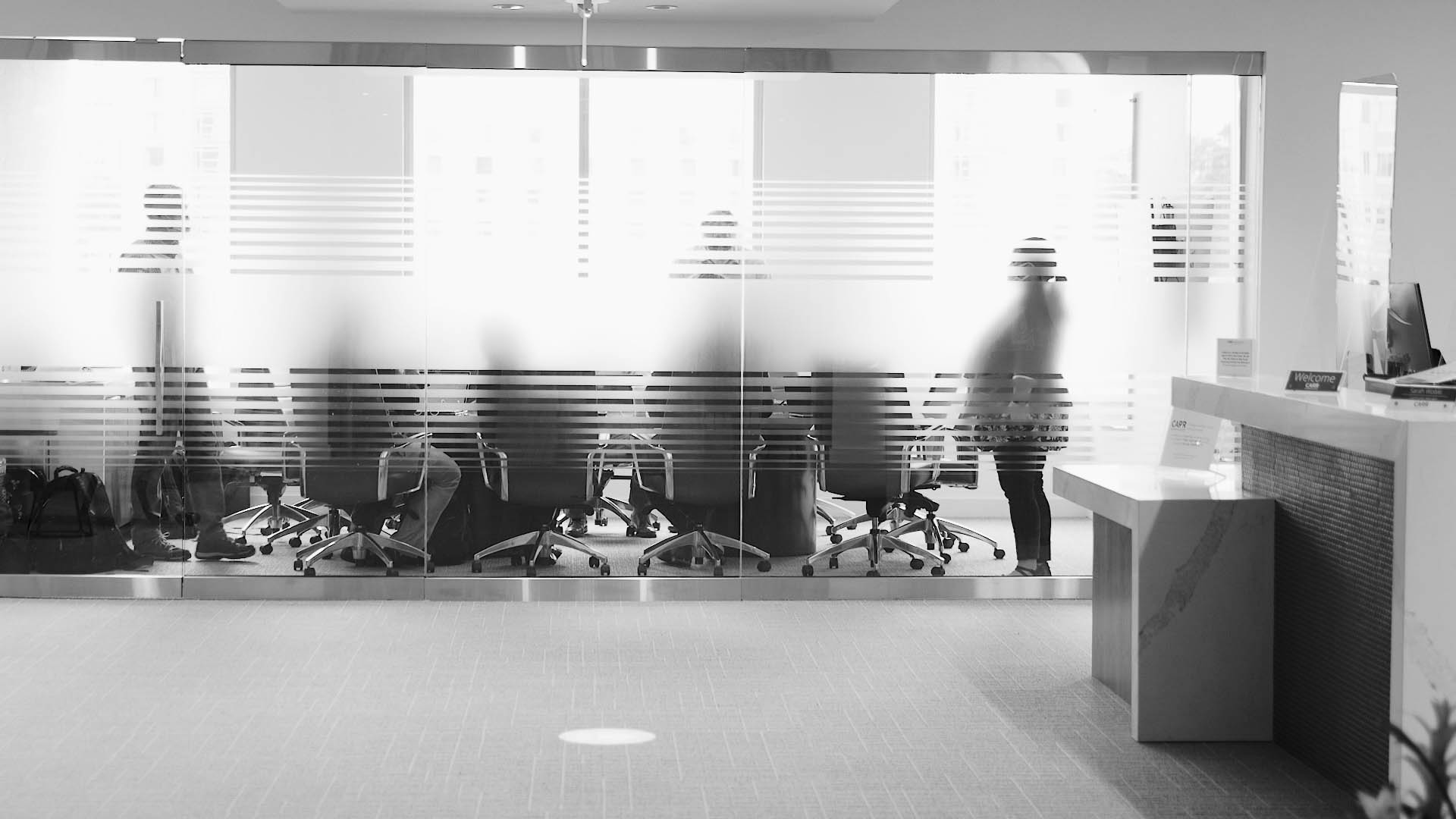 a group of people meeting inside a conference room